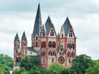 The seven towers of Limburg Cathedral stand for the seven sacraments.