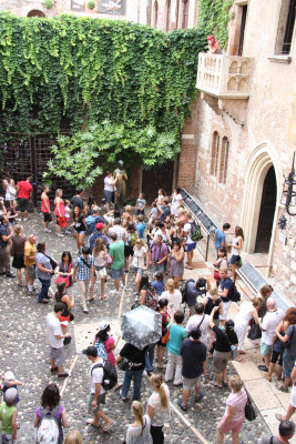 "Numerous visitors come to the patio of ""Juliet's house"" to see the famous balcony and caress Juliet's right breast."