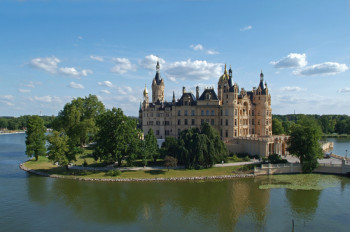 Schwerin Palace lies picturesquely on a small island in the Lake of Schwerin.