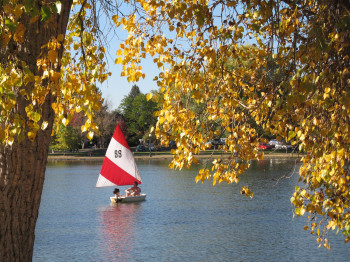 Tons of activities to do: Couple in a boat during fall at Washington Park.