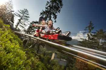 The alpine coaster Osttirodler in Lienz makes for thrilling rides and breathtaking experiences.