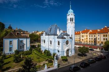 The church's striking blue color makes it unique.