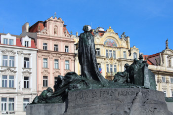 The statue of Jan Hus is located at the centre of Old Town Square.