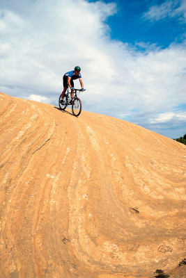 The slickrock sandstone is not slick at all, rather it has a surface much like sandpaper, which means that the rubber tires of a mountain bike grip readily to its surface.