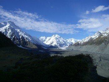 Standing on the edge of the glacier moraine of Tasman Glacier