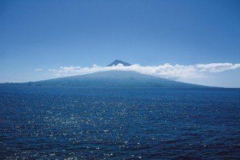 The island as seen from the ocean, with the Pico volcano in the background.