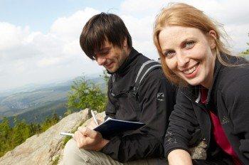 Sign the summit book up on Fichtelberg mountain.