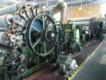 Bei einer Führung erfährst du Vieles über die Textilmaschinen und deren Funktionen.