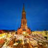 Der Ulmer Weihnachtsmarkt befindet sich neben dem größten Kirchturm der Welt, dem der Ulmer Münster.