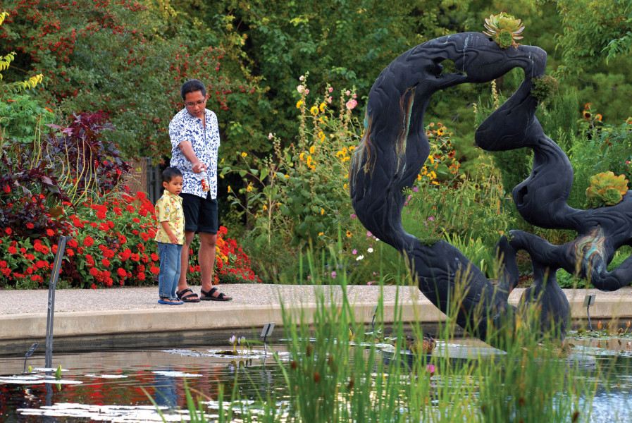 Father And Son Enjoying A Nice Afternoon At The Denver Botanic Gardens.