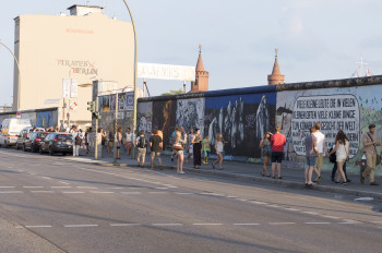 The gallery is located at longest remaining section of the Berlin Wall.