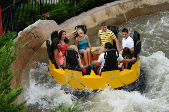 Tourists riding Disaster Canyon at Elitch Gardens Theme & Water Park.