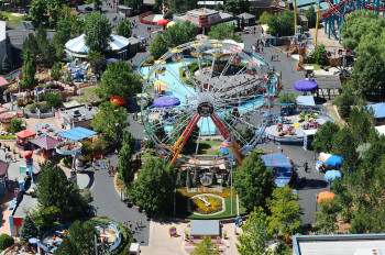View of the amusement park with roller coasters among other thrill rides plus arcade & shows.