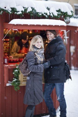 A couple enjoying their time at the snowy Gamla Stan Christmas Market