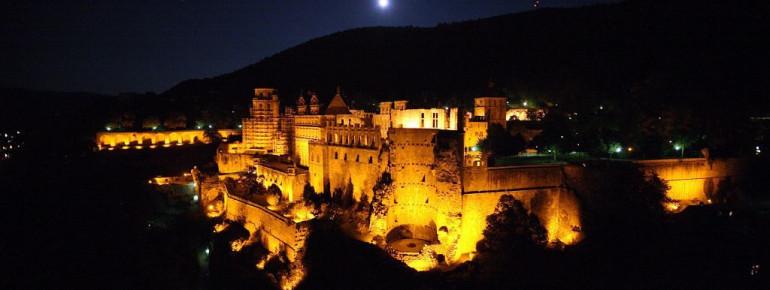 Heidelberg Castle is illuminated at night.