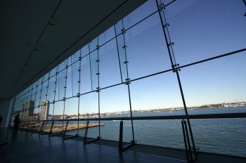 A view on the sea through the glass front of the museum