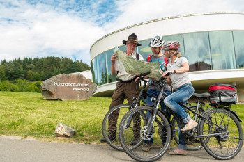 Cyclists with a ranger in front of the national park centre.