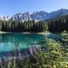 Lago di Carezza is also known as the Rainbow Lake.