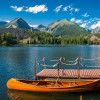 Enjoy the picturesque mountain panorama from a little boat.