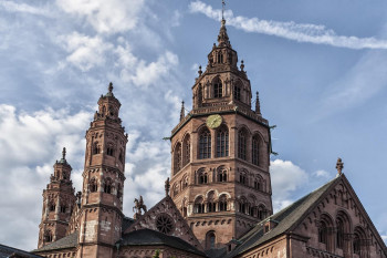 The western group of towers was rebuilt in the 18th century in the Baroque style after a fire.