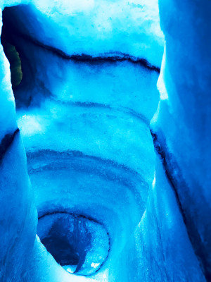 The dark stripes in the ice show you exactly how Iceland's glaciers are characterized by steady volcanic eruptions.