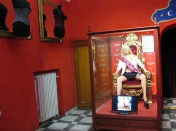 A lifelike rubber doll welcomes visitors at the entrance hall.
