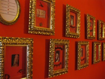 Body decoration and piercings are displayed in picture frames along the hallways.