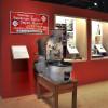 An old coffee roaster on display.