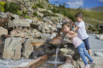 Children play at the watercourse.