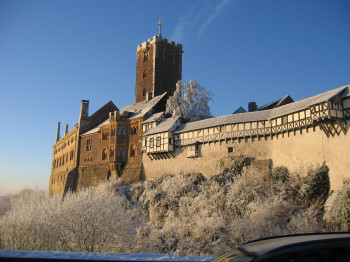 You can see the 3-metre-tall golden cross ontop of the castle's bergfried tower.