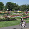 People enjoying Washington Park during the summer. In the background: Its colorful flowerbeds.