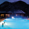 The outdoor pool by night at Premia Spa
