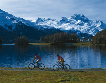 Biking or hiking with Alpine backdrop - another great activity at Lake Silvaplana.